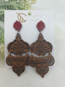 Double piece Moroccan patterned earrings and paired with a dark red post. Made from queensland walnut.