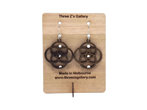 Wooden circular earrings by Three Zs Gallery