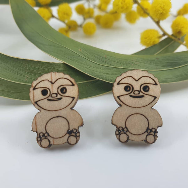 Wooden sloth stud earrings. Hypoallergenic posts which is fine for sensitive ears.