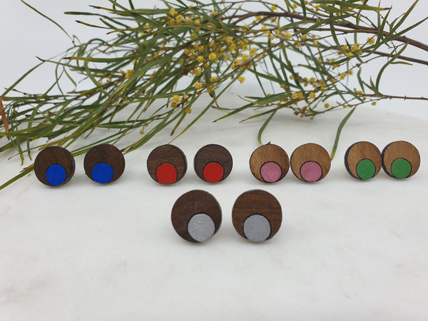 Round wooden studs with a dot of colour. Hypoallergenic posts. 2.5cm in width. Made from eucalyptus or queensland walnut.