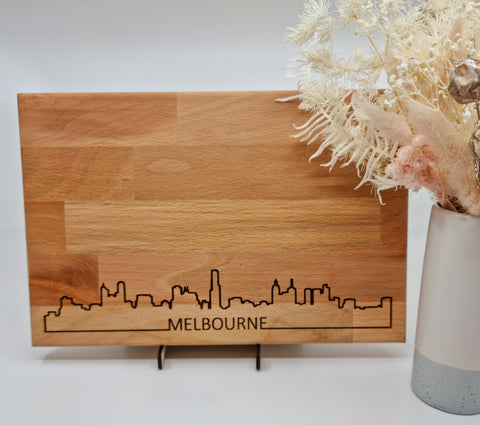 Wooden cheese board with Melbourne skyline