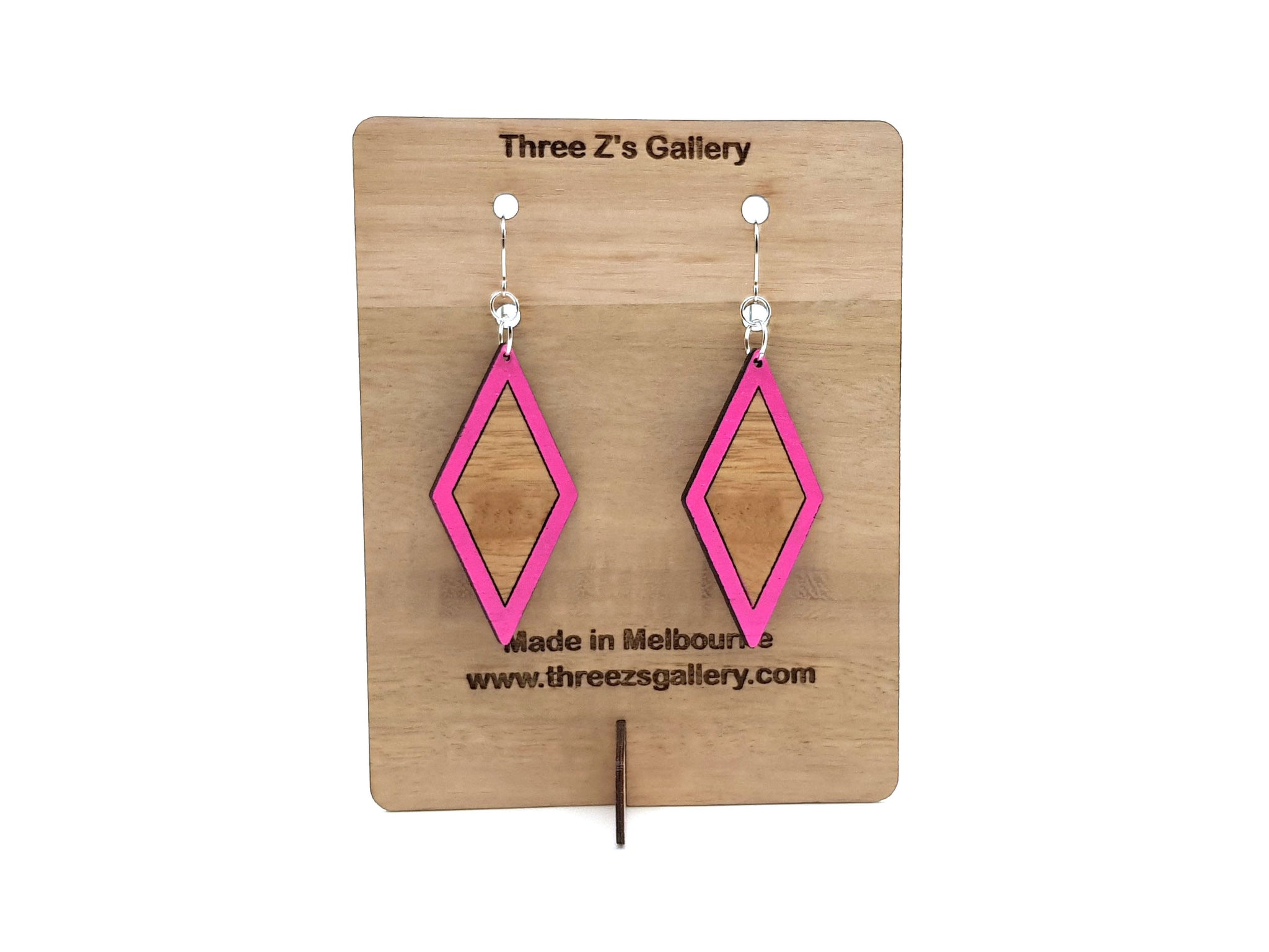 Diamond shaped earrings with a painted edge to highlight the grain of the wood.  measures 7cm in length and made with hypoallergenic surgical steel hooks.