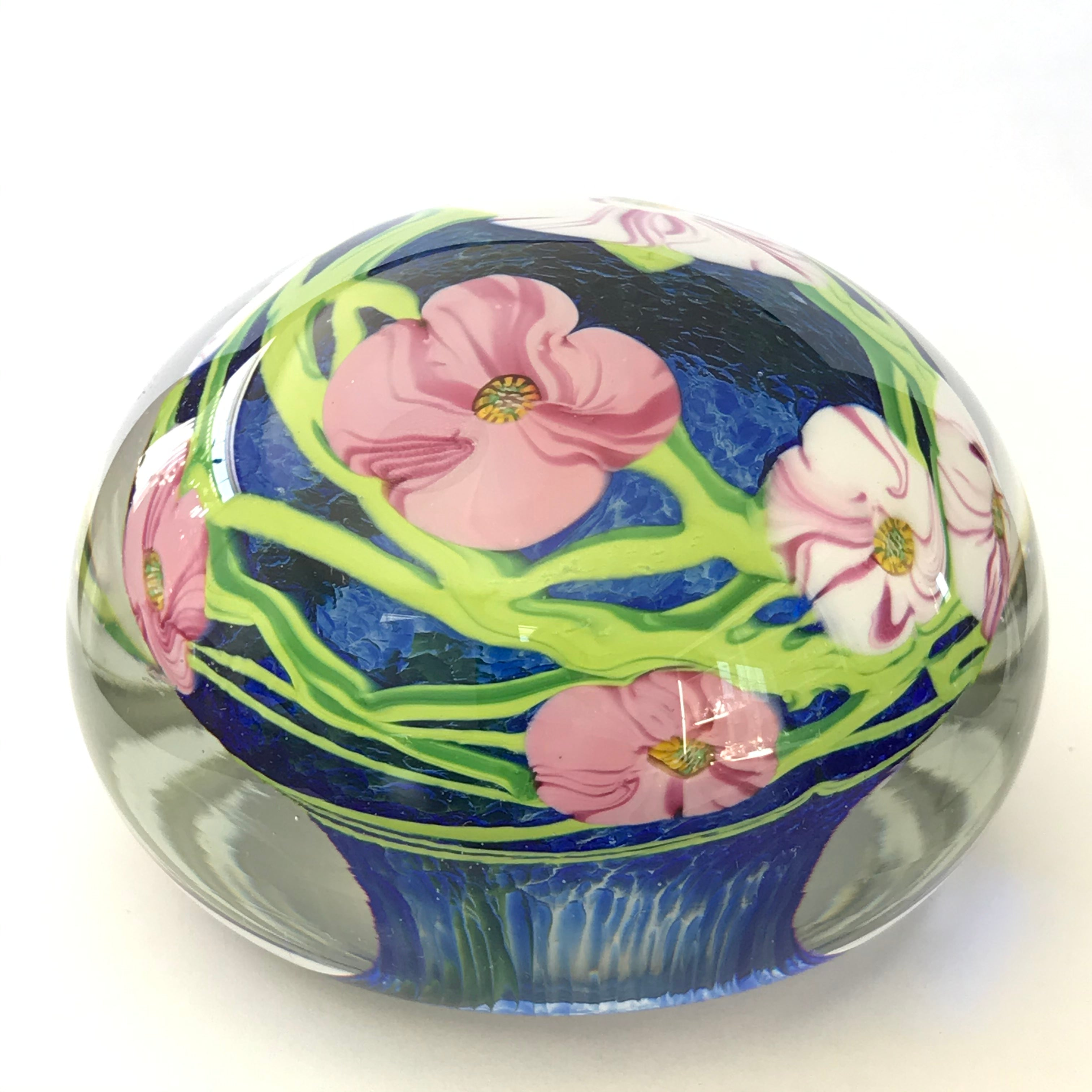 Unmarked magnum paperweight with flowers with millefiori center