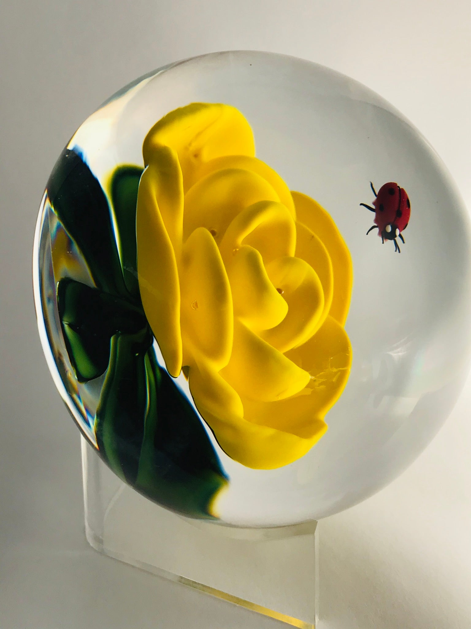 A Richard Loesel yellow crimp rose with ladybug paperweight