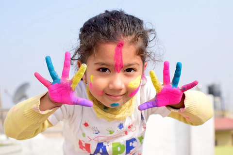 child with colorful hands
