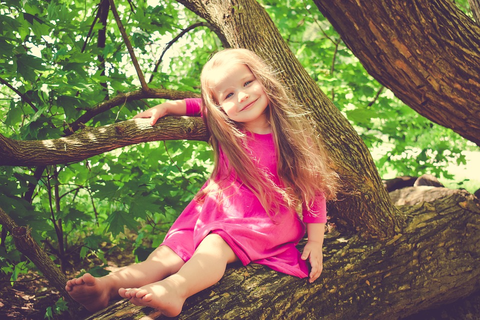 toddler girl on a tree