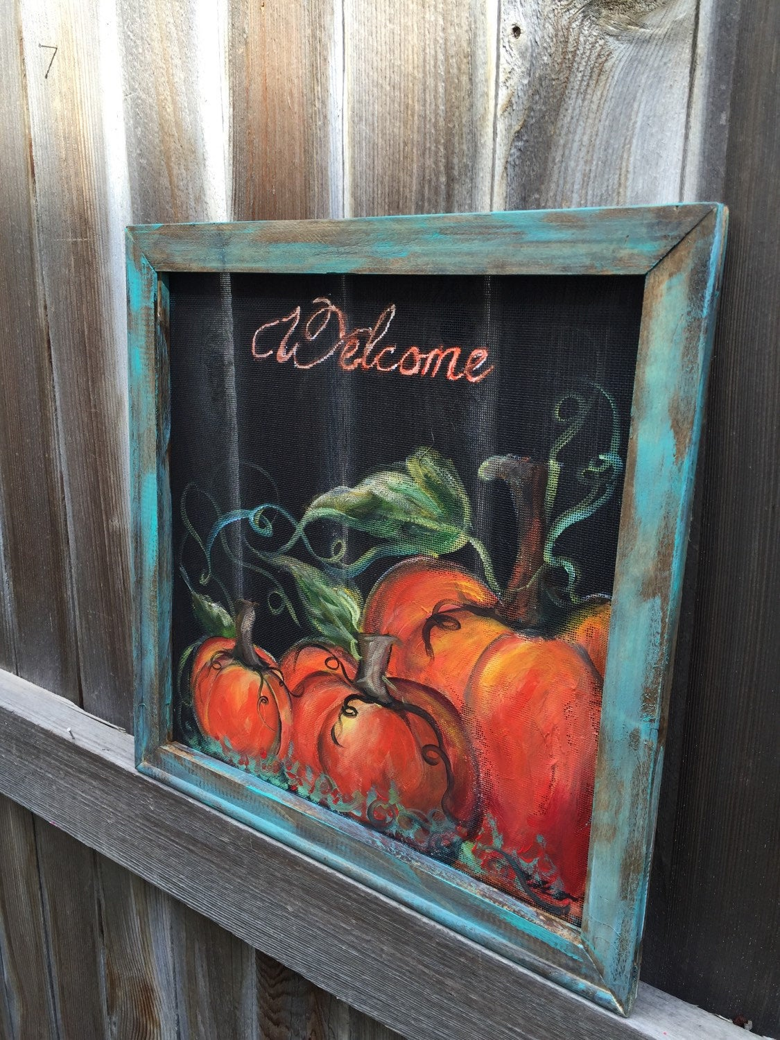 Rustic pumpkin welcome sign with teal frame