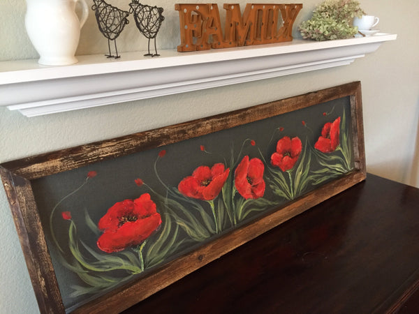 Fields of red poppieswith pallet wood frame