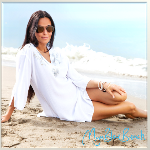 Electra White beach Kaftan , the perfect white caftan to wear with jeans or over Swimwear. Shop White kaftans in UK. Shop white kaftans in USA.