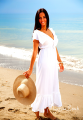 The ruffles of the Carrie Dress Slim the bodyas they take the eye away as they float in the breeze making  these #BeachDresses perfect for your #BeachHoliday