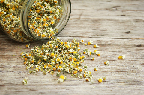 Jar of organic chamomile, a plant with natural anti-anxiety and calming effects.