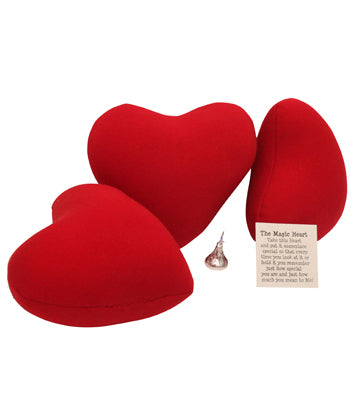 Three red pillow hearts