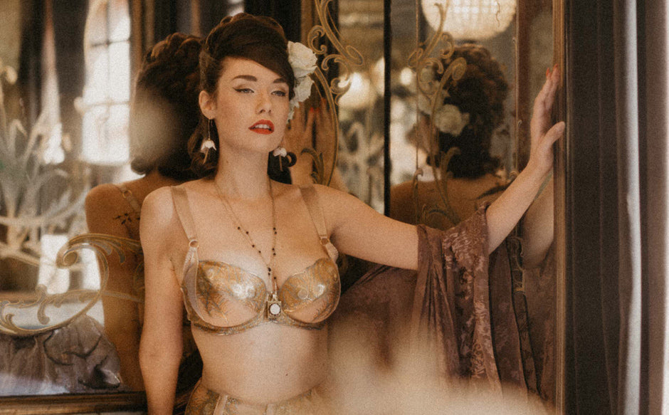 Vintage model Alba Banana wears Juliette Hazel DD+ cup gold lingerie in Paris