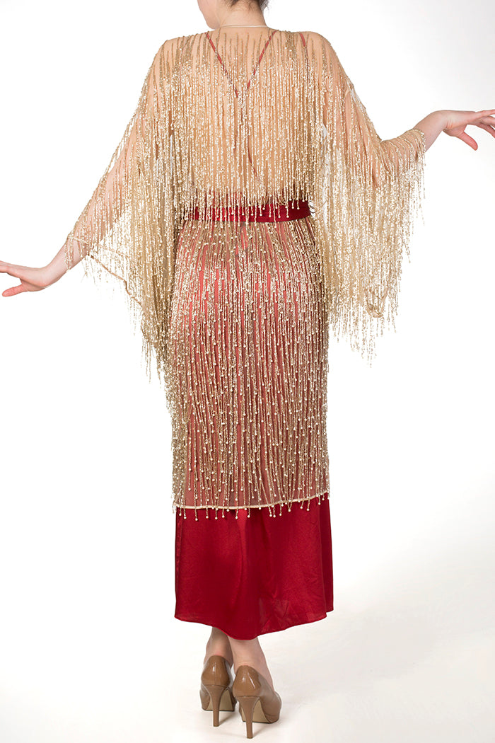 Dramatic gold beaded robe with red silk gown