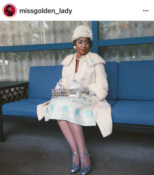 Missgolden lady wearing blue vintage dress and 60s style cream coat