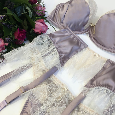 Purple lingerie set in silk and lace with bra, garter and thong