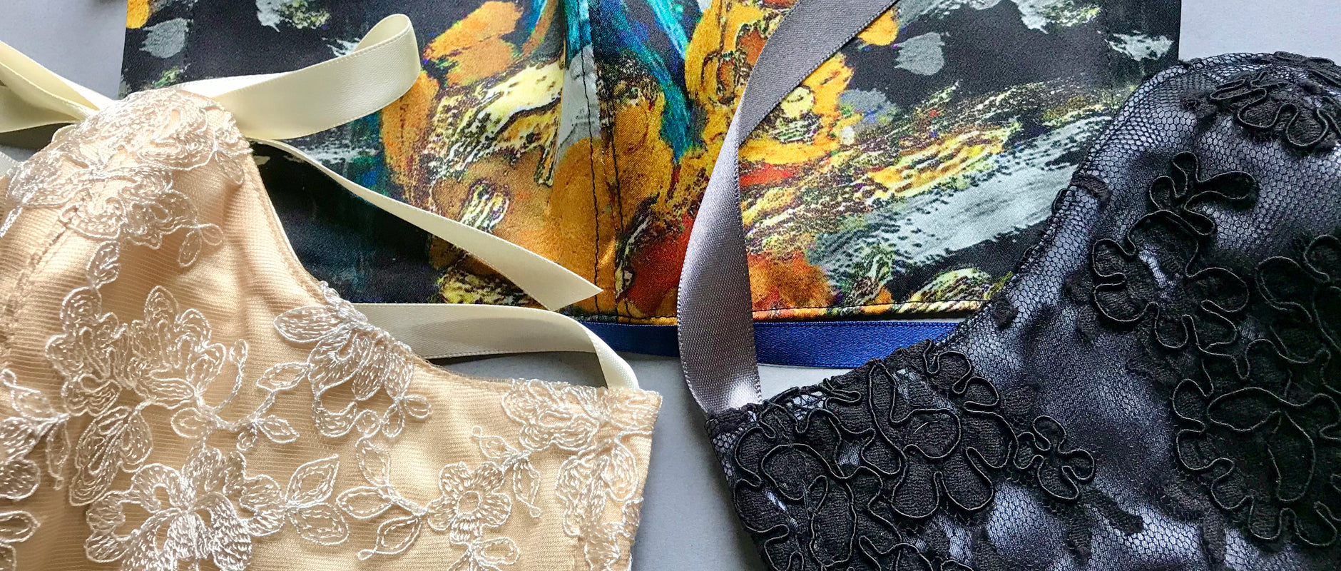 Silk face mask coverings with cotton inner layer, silk lining and print and lace decoration