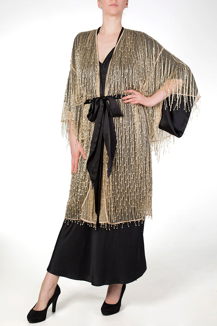 Cassiopeia black silk robe worn underneath matching luxury gold beaded robe