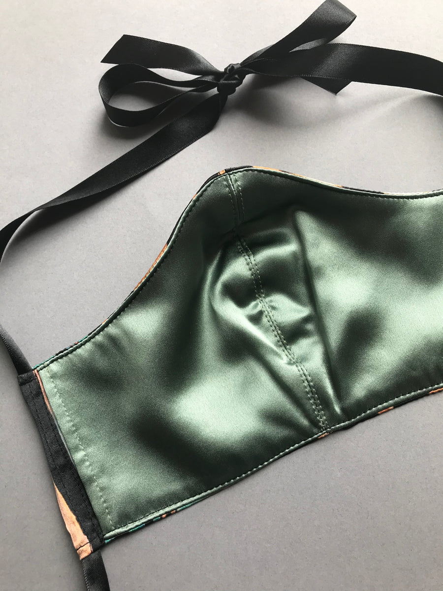 Silk lining on face mask covering with filter pocket and ribbon ties