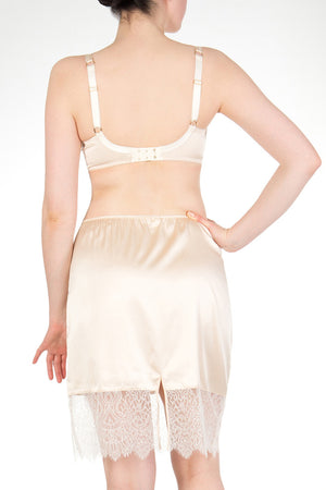 Half slip skirt in cream silk and ivory lace with silk binding on back split