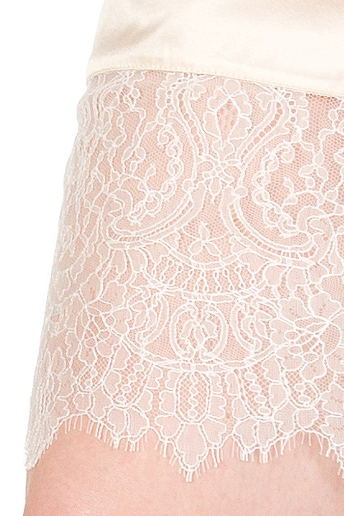 Ivory lace detail on silk half slip hem, in fine French lace
