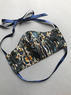 Designer silk face mask with filter pocket in blue and gold print