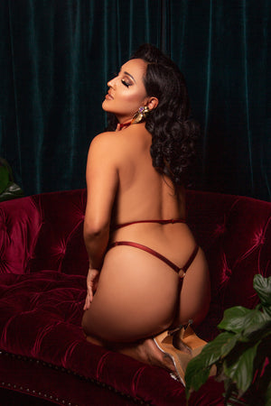 Luxury boudoir thong in red strapping with gold ring back detail