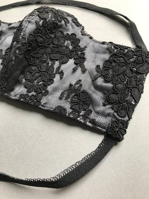 Lace detail on silk face covering with elastic bands