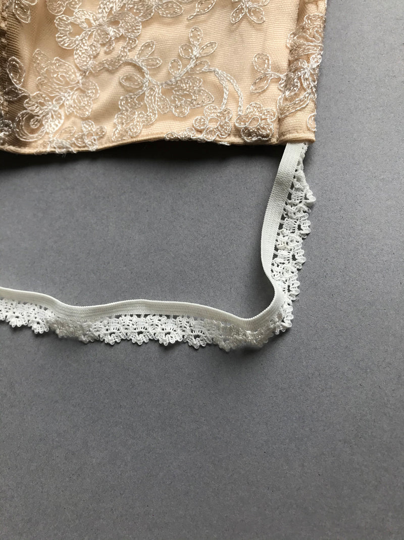 Decorative elastic trim on luxury silk and lace face mask