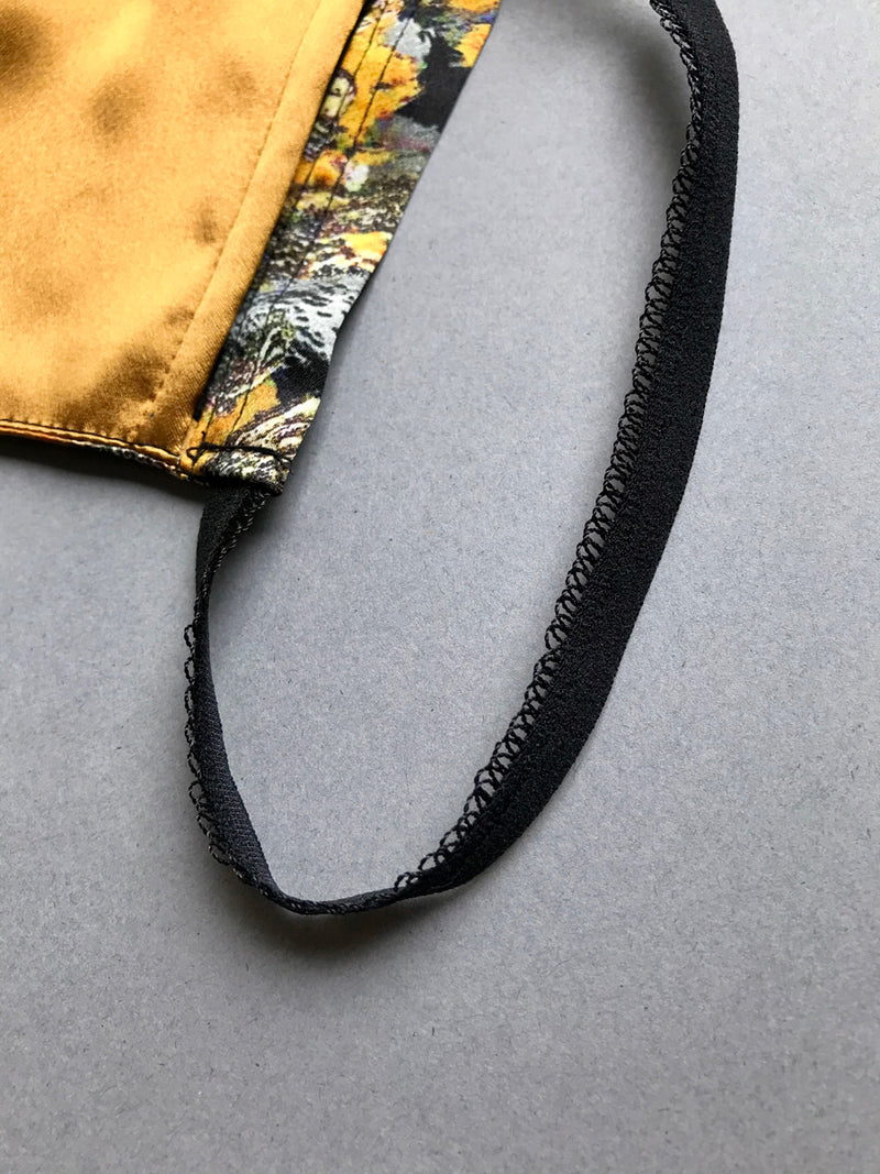 Decorative edge elastic loop on luxury silk face mask covering