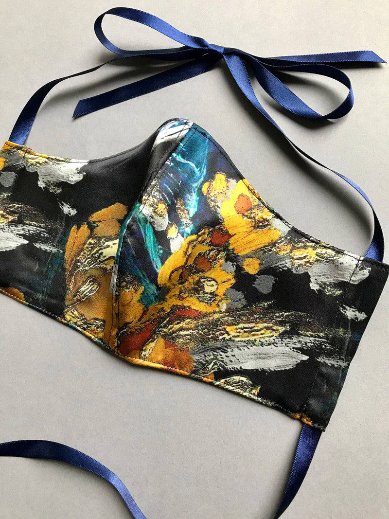 Silk face mask in blue and gold print with triple layer silk and cotton and inner filter pocket