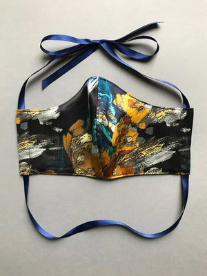 Beautiful silk face mask in blue and gold print with triple silk and cotton layers and ribbon tie
