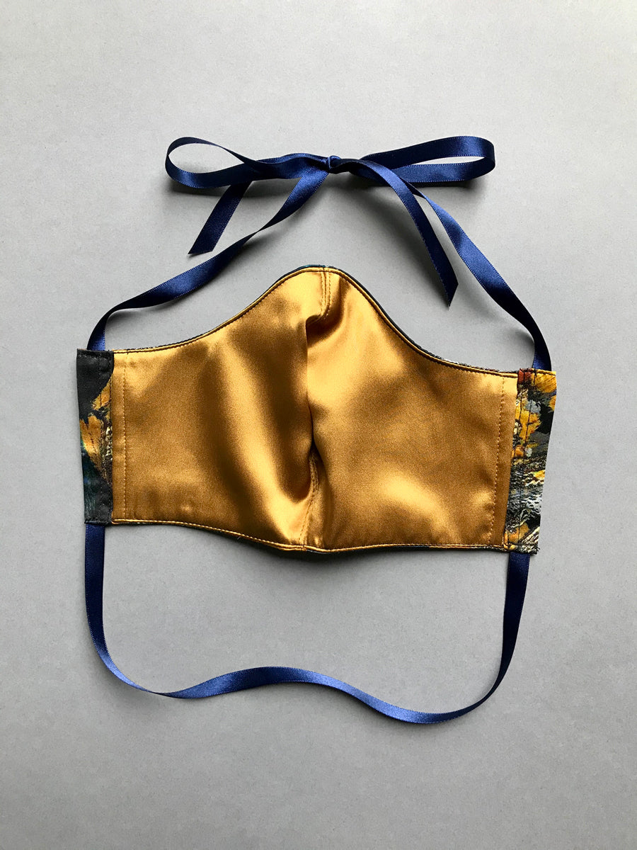 Gold silk lining on luxury silk face mask with inner cotton layer, filter pocket and ribbon tie