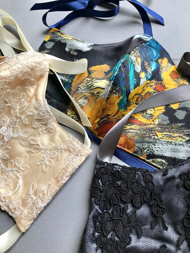 Lace and print detail on set of 3 silk face mask coverings with fitted shape and silk linings