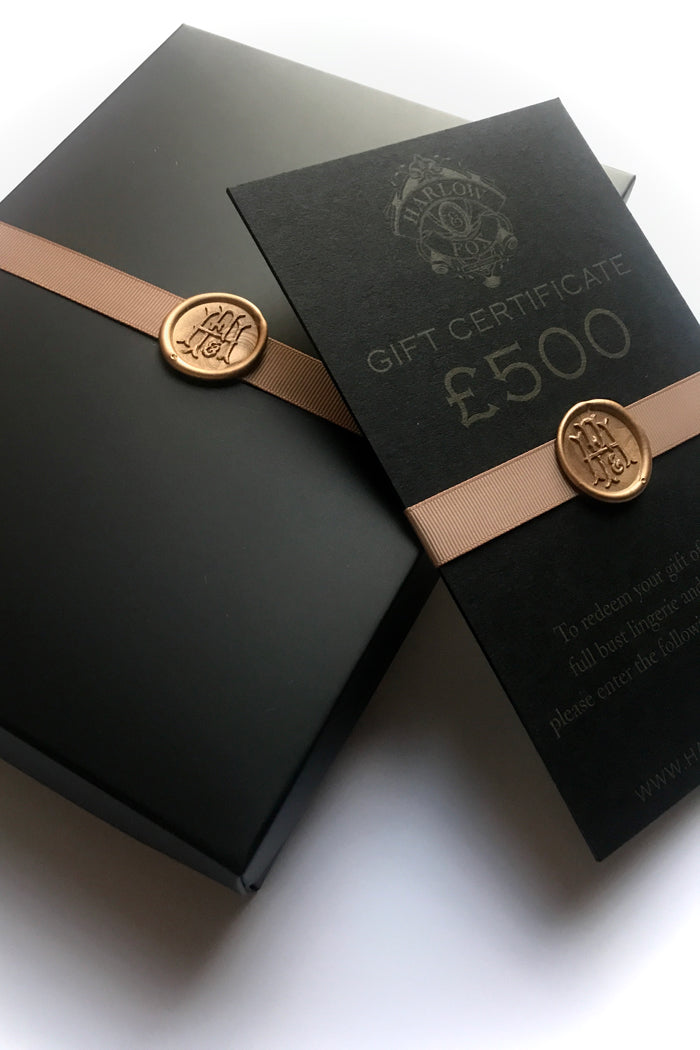 Luxury lingerie gift card packaged in black and gold gift box