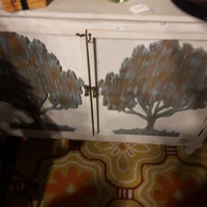 Painted White Cabinet with Trees