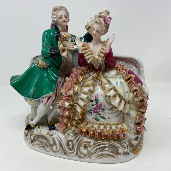 Courting Victorian Style Porcelain Figurines on Sofa