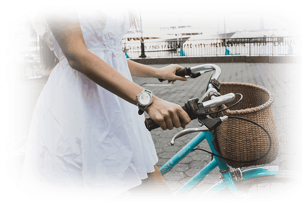 Woman walking and riding her bike with watch on