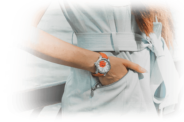 Woman wearing watch with hands in her pocket