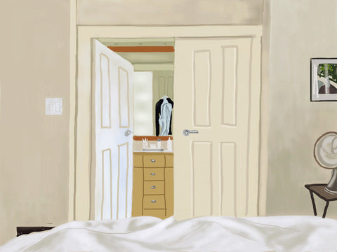 Interior by Ryan Nickerson. A calm white and cream bedroom interior with view from bed to a door that is ajar leading to a dressing room.