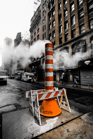 Sewer Smoke by Barry Khan. Photograph pf a streetscape with smoke and an orange and white pylone.
