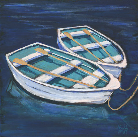 White Row Boats by Nancy Ruhl. Image of two white row boats in blue water.