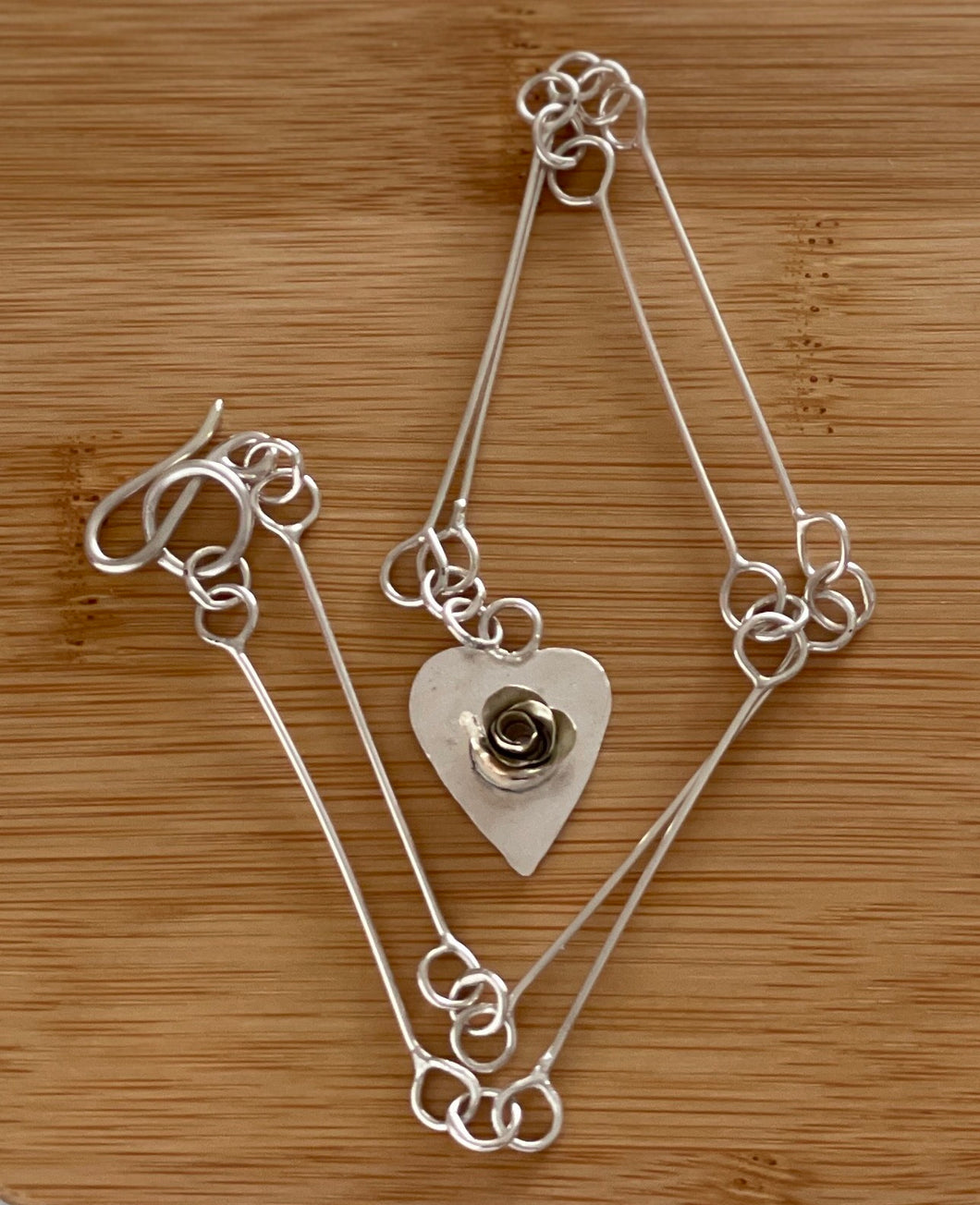Rose on a heart necklace