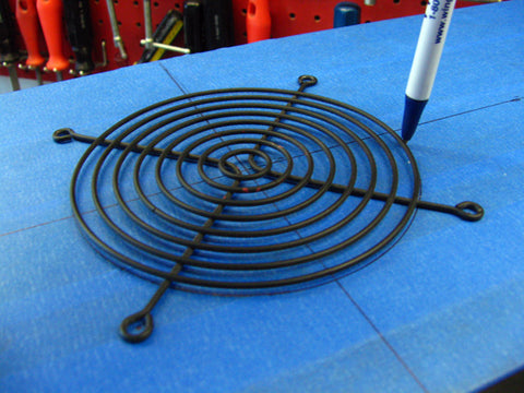Draw outline around the 120mm wire fan grill