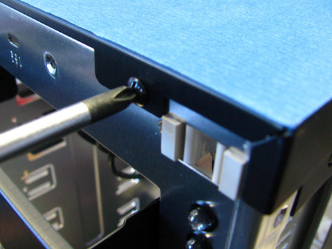 Unscrew and remove on the PC top panel.
