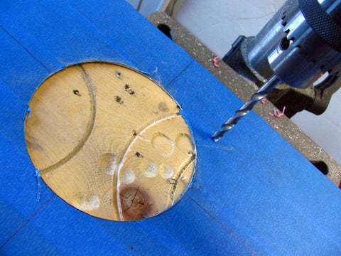 "You will need to drill the fan screw mounting holes next. I prefer using 1/4"" size drill bit."