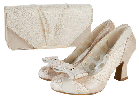 https://www.belledivino.co.uk/collections/bridal/products/ruby-shoo-tatum-gold-court-shoe-with-removable-bow-matching-tblisi-bag