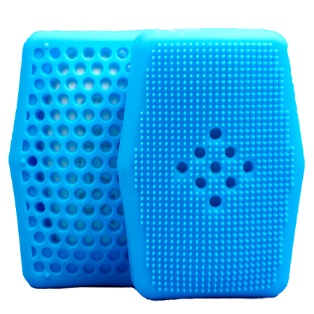 2 Sud Stud V2s showing both soap saving honeycomb pattern and exfoliating bristle side.