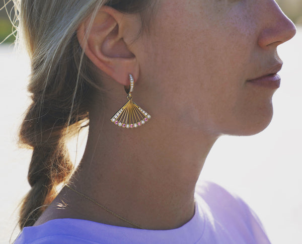 Pink spinel and diamond fan-shaped earrings worn.