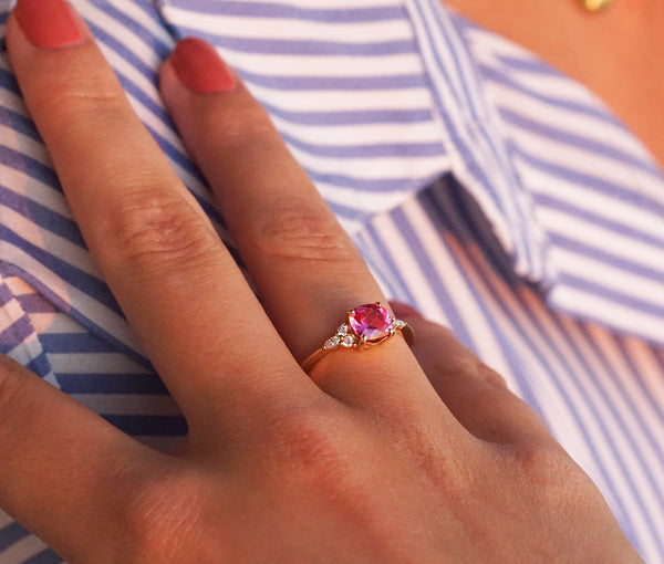 Pink spinel and diamond ring on hand